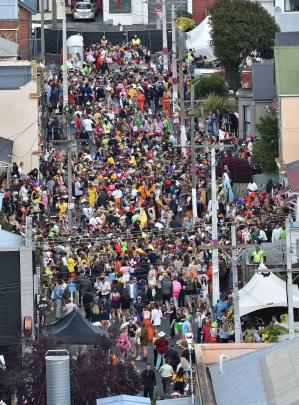 Party-goers pack Hyde St for the annual event on Saturday.