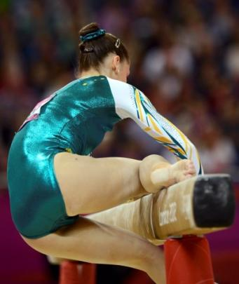Georgia Bonora of Australia slips as she competes on the balance beam during the women's...