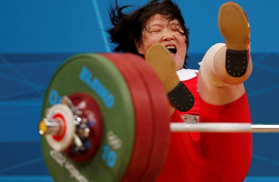 North Korea's Jong Sim Rim falls after failed attempt on the women's 69kg Group A weightlifting...