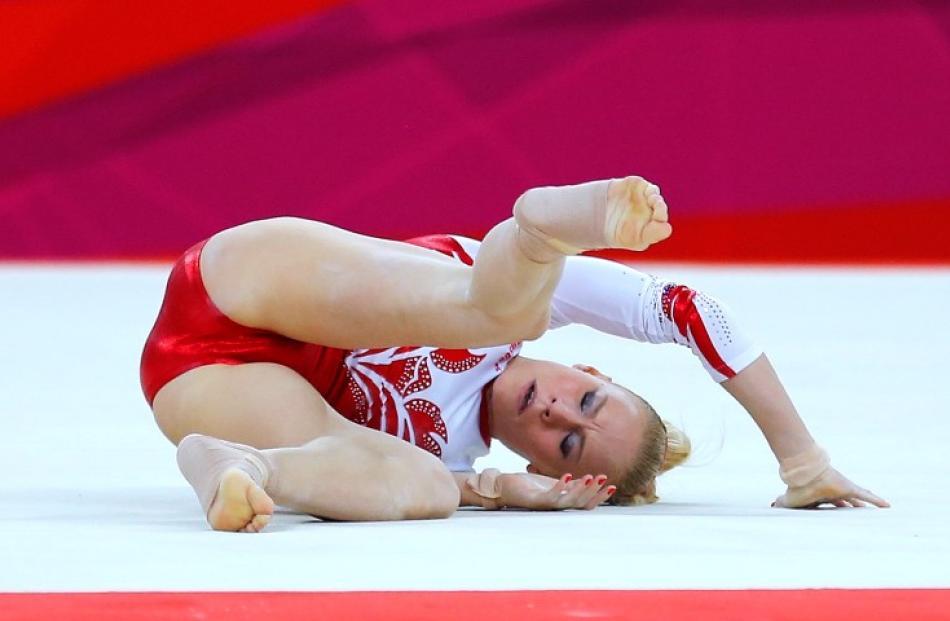 Russia's Kseniia Afanaseva falls during her floor exercise during the women's gymnastics team final.