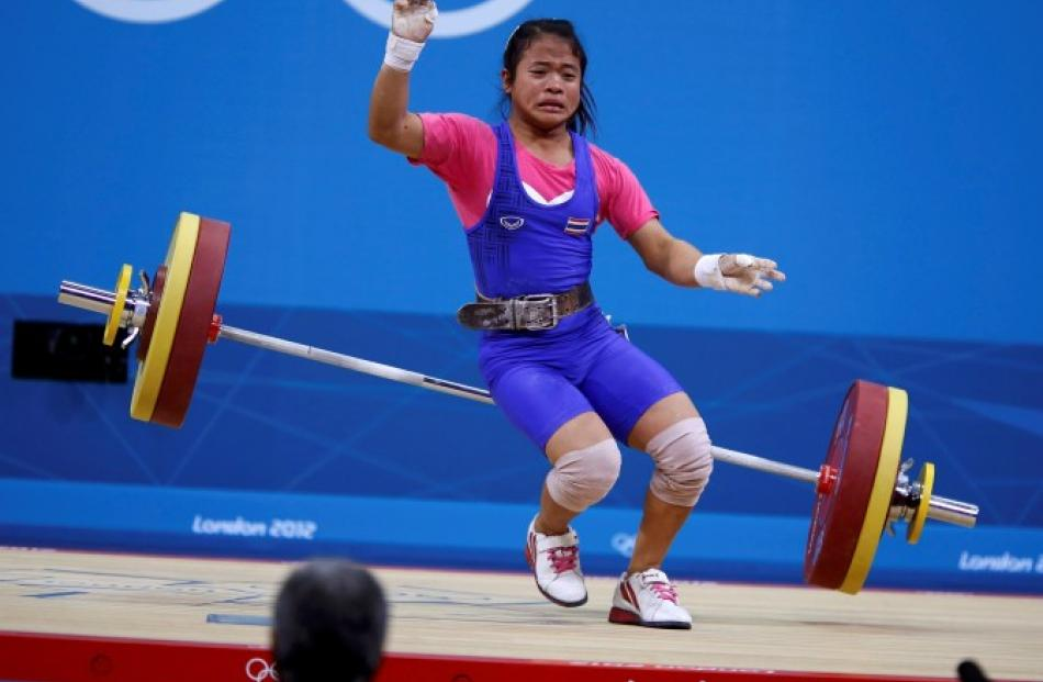 Thailand's Sirivimon Pramongkhol drops weights on the women 48kg Group A weightlifting competition.