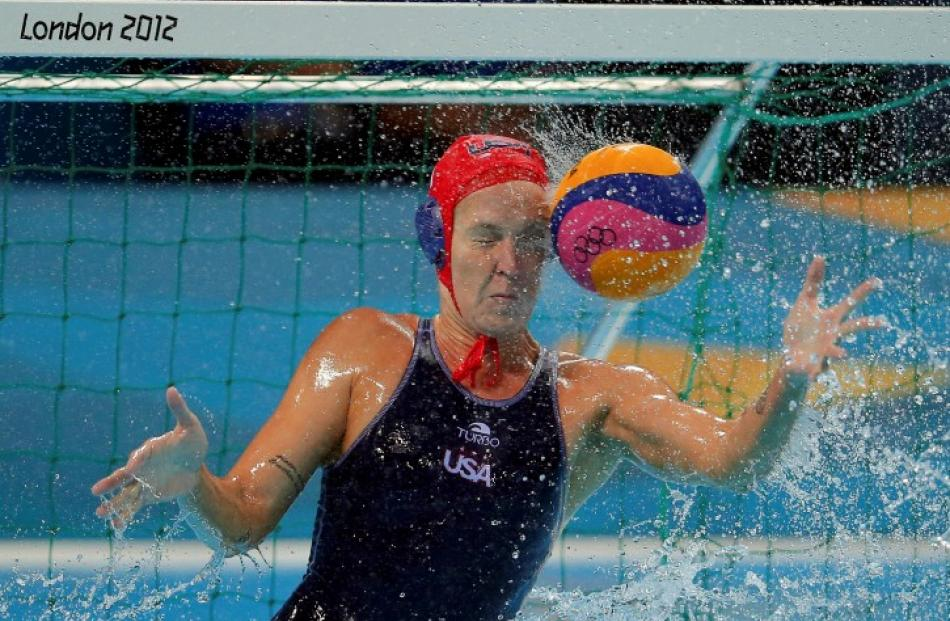 US goalkeeper Betsey Armstrong is hit by the ball during their women's preliminary round Group A...