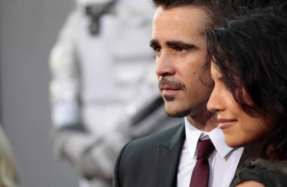 Actor Colin Farrell and his sister Claudine poses at the premiere of 'Total Recall' at the...