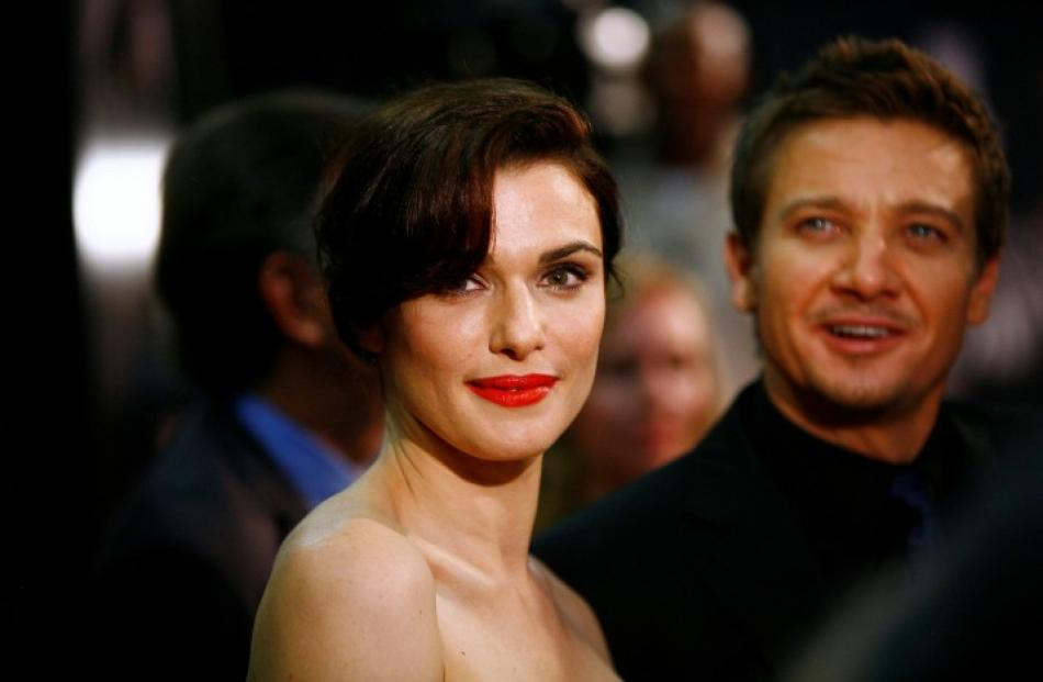 Cast members Rachel Weisz and Jeremy Renner attend the premiere of the film 'The Bourne Legacy'...