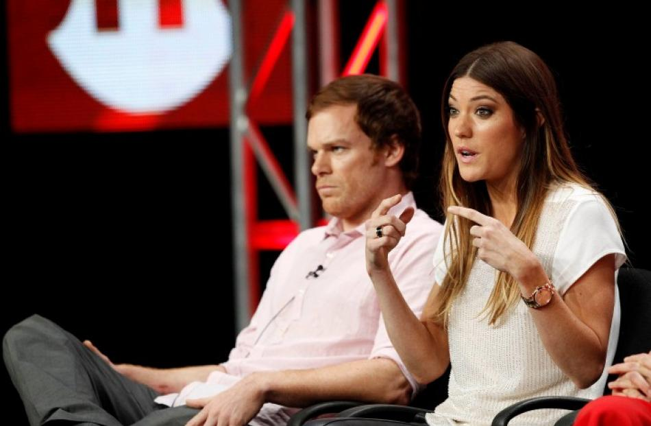 Jennifer Carpenter speaks nest to co-star Michael C. Hall at a panel for 'Dexter' during the...