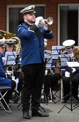 Cornet player Mat Patchett, of the Kaikorai Metropolitan Brass Band, plays the Last Post at the...