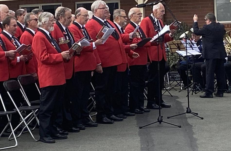 The Dunedin RSA Choir stand to sing during the Montecillo Anzac Service. PHOTO: BRENDA HARWOOD
