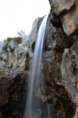 A waterfall is one of the features inside the Dunedin Chinese Garden.