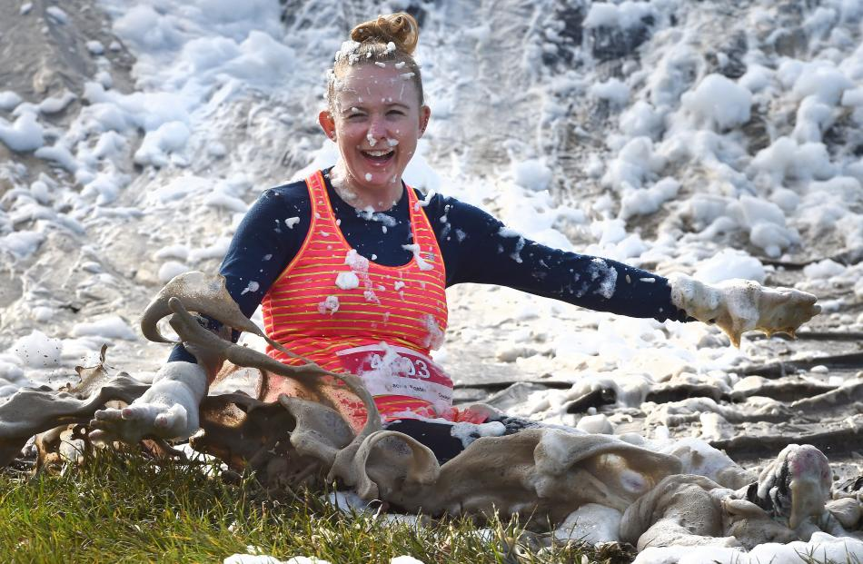 Jackie Foster, second to finish the women's 10km race, completes her slide down a bank. PHOTOS:...
