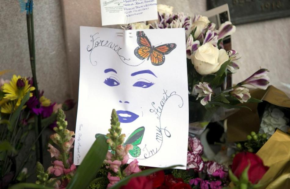 Flowers and notes left by fans on Marilyn Monroe's crypt in Pierce Brothers Westwood Village...
