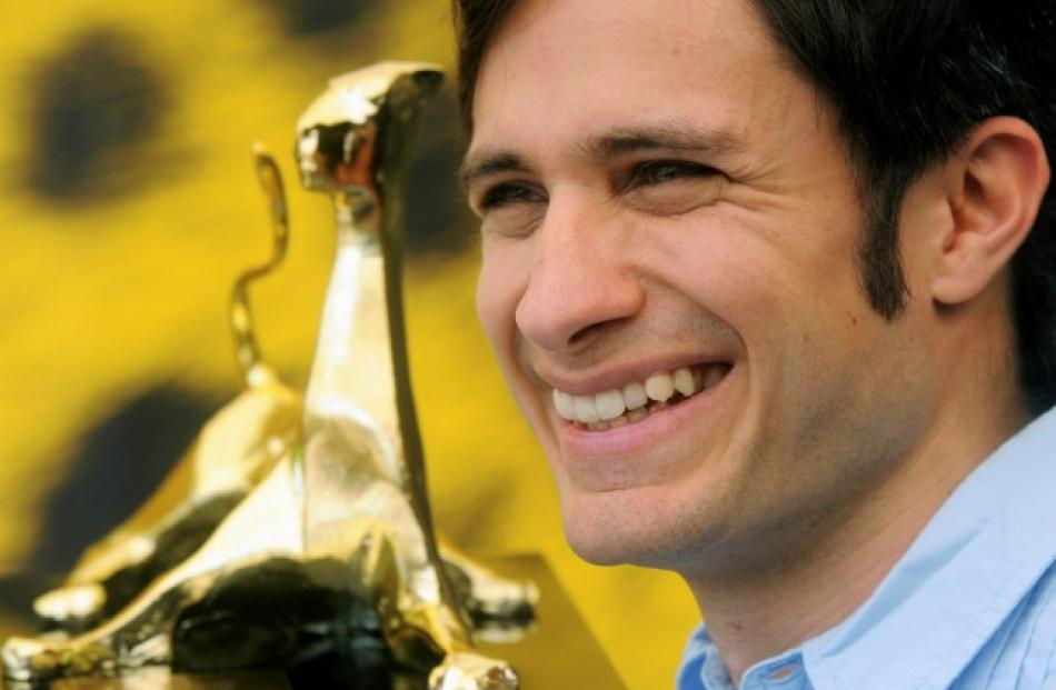 Mexican actor Gael Garcia Bernal poses with his Excellence Award during a photocall at the 65th...