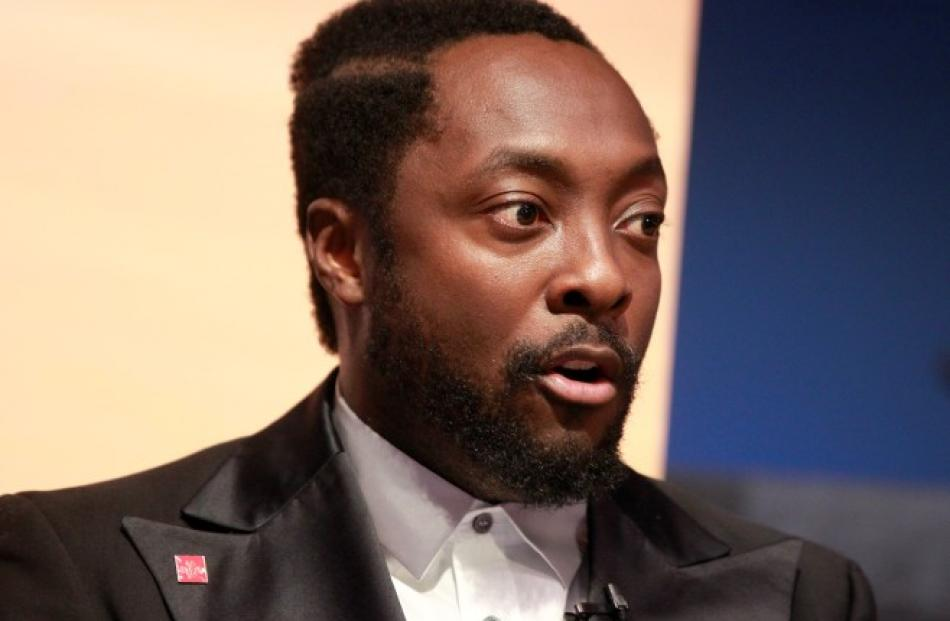 Musician will.i.am speaks during a news conference at NASA's Jet Propulsion Lab in Pasadena,...