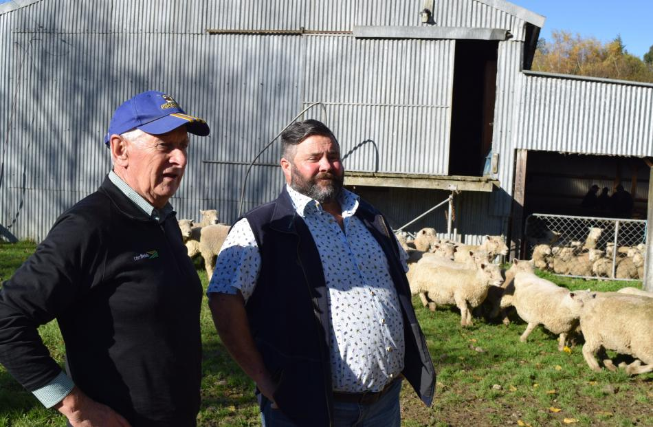 Southern Southdown Breeders Club member Roger Keach (left), of Waihola, and chairman Rob Hall, of...