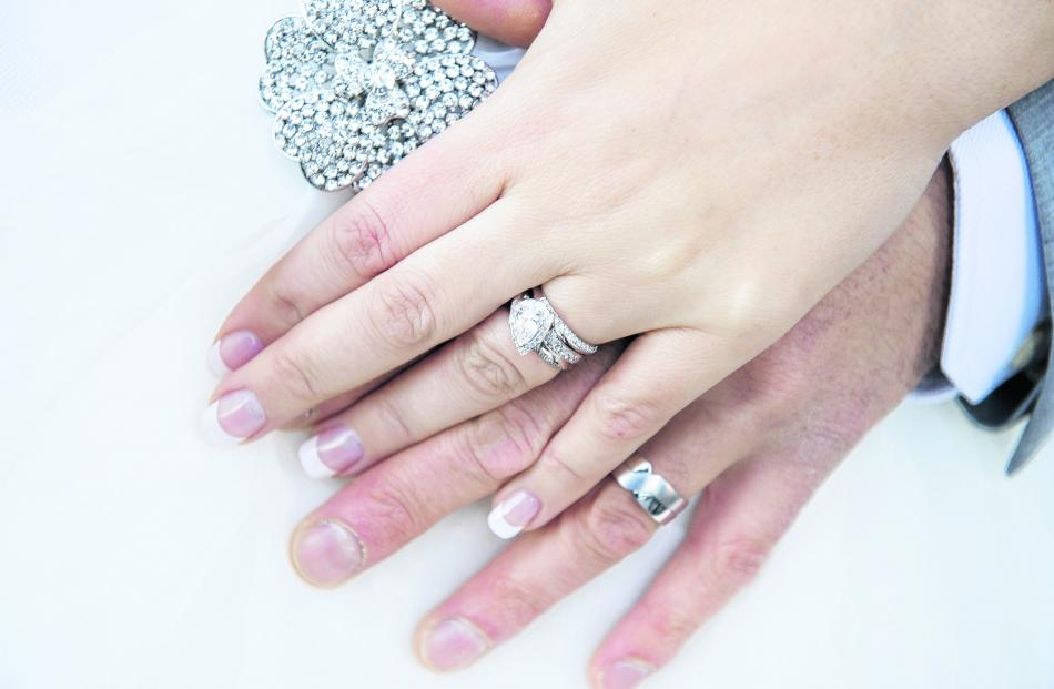 The rings of Carlie and Marcus Baker, who married in Queenstown. ASPIRING PHOTOGRAPHY.