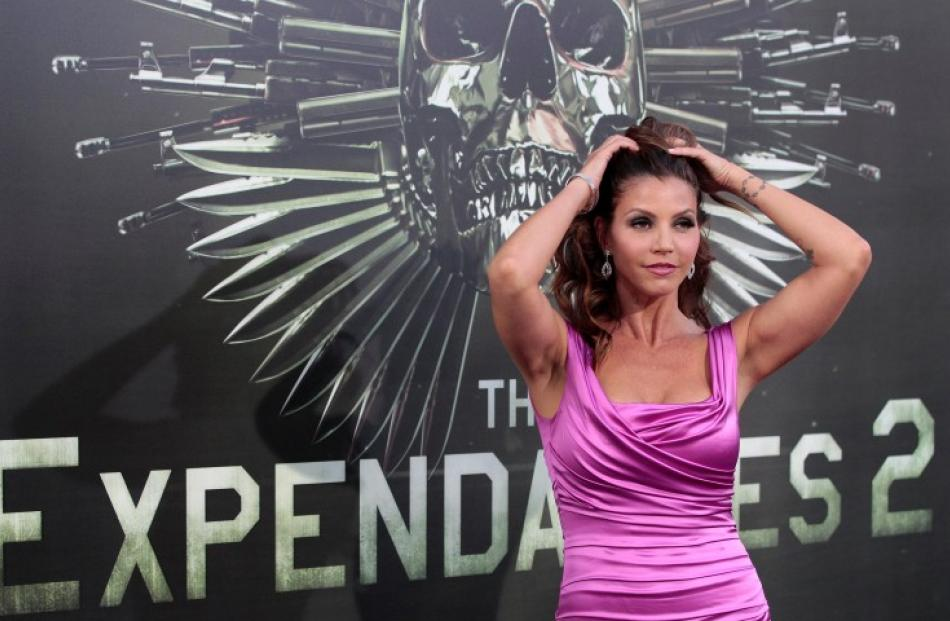 Cast member Charisma Carpenter poses at the premiere of 'The Expendables 2' in Hollywood. REUTERS...