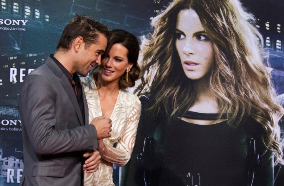 Cast members Colin Farrell (L) and Kate Beckinsale talk on the red carpet before the Germany...