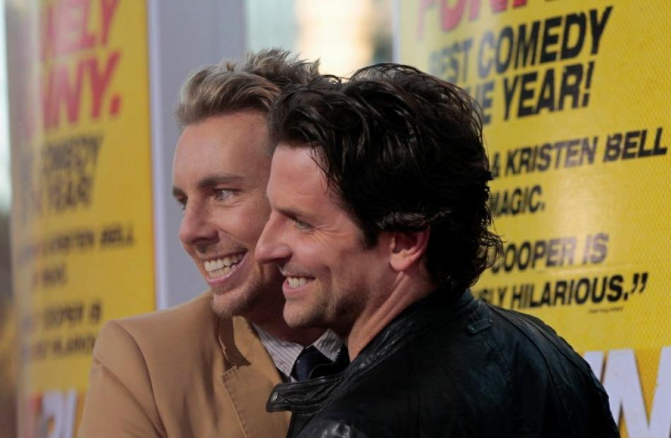 Cast members Dax Shepard (L) and Bradley Cooper attend the premiere of 'Hit and Run' at Regal...