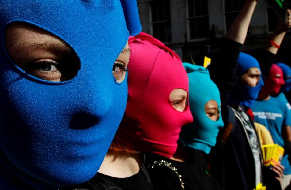 Protesters take part in an Amnesty International flash mob demonstration in support of Russian...