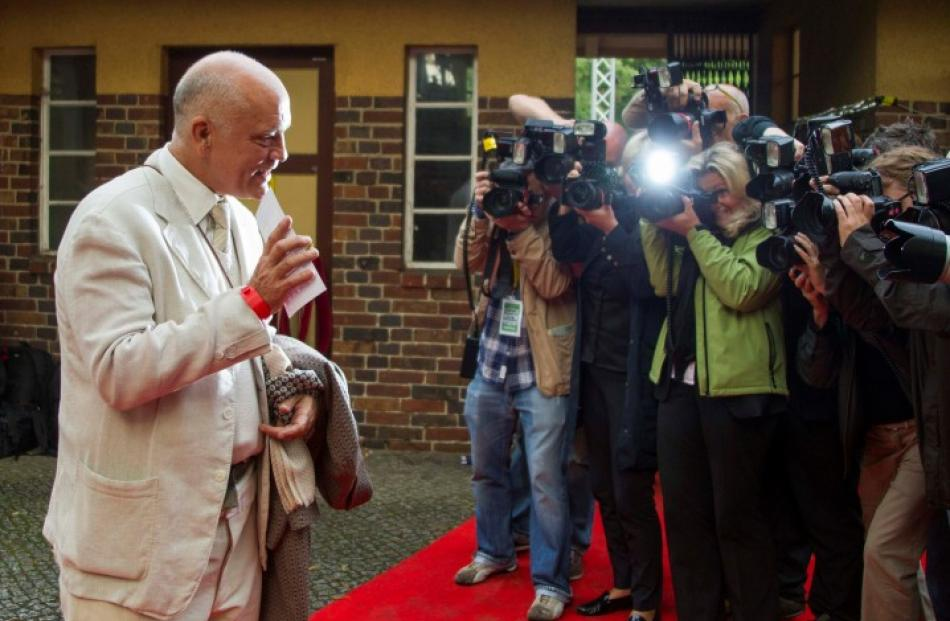US actor John Malkovich arrives for the premiere of the opera 'Carmen', directed by Volker...