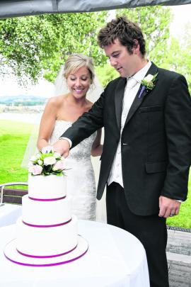 Melissa Harris and Ben McFarlane cut the wedding cake at their wedding in February, at Edgewater...
