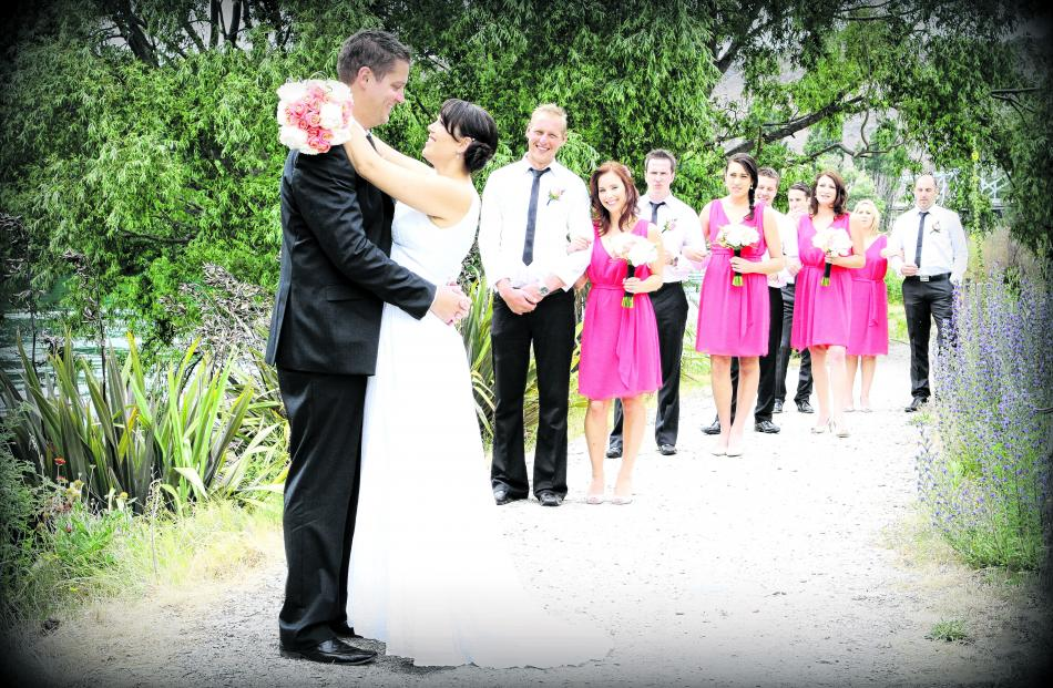 With their wedding party are Patrick and Melissa Fuller, who were married in Dunedin in January....