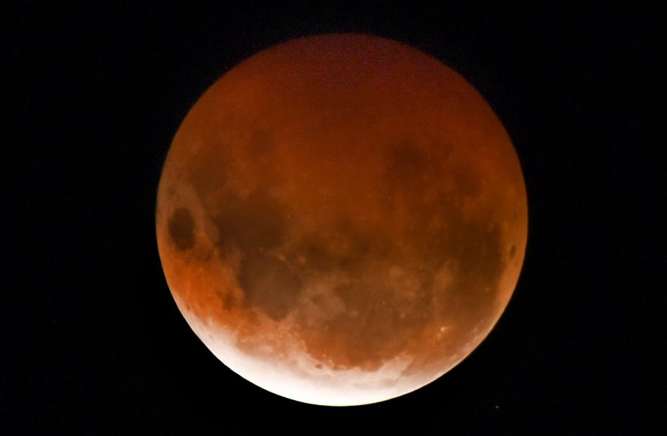 The super blood moon appears over Dunedin last night. Photo: Stephen Jaquiery/ODT