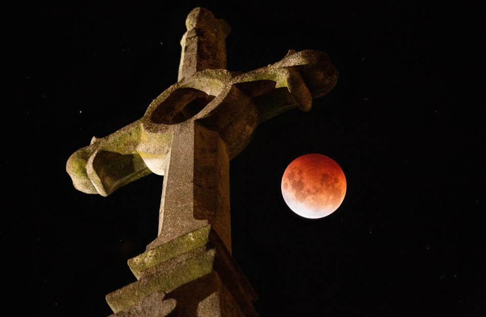 Nicholas Sherlock took this composite of two photos at Dunedin's First Church, as both the cross...