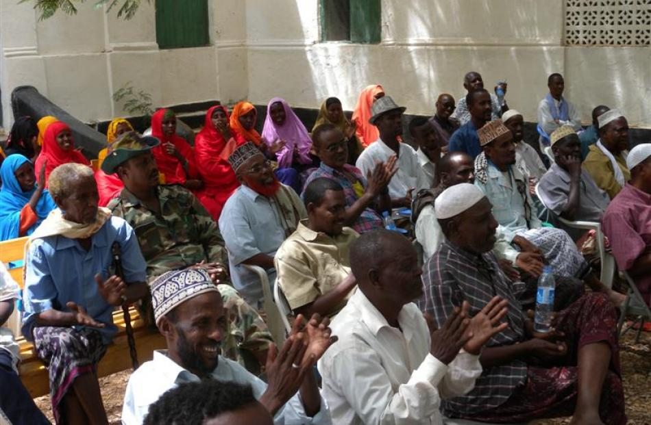 Baidoa community representatives are seated at the public meeting to meet a Somali government and...