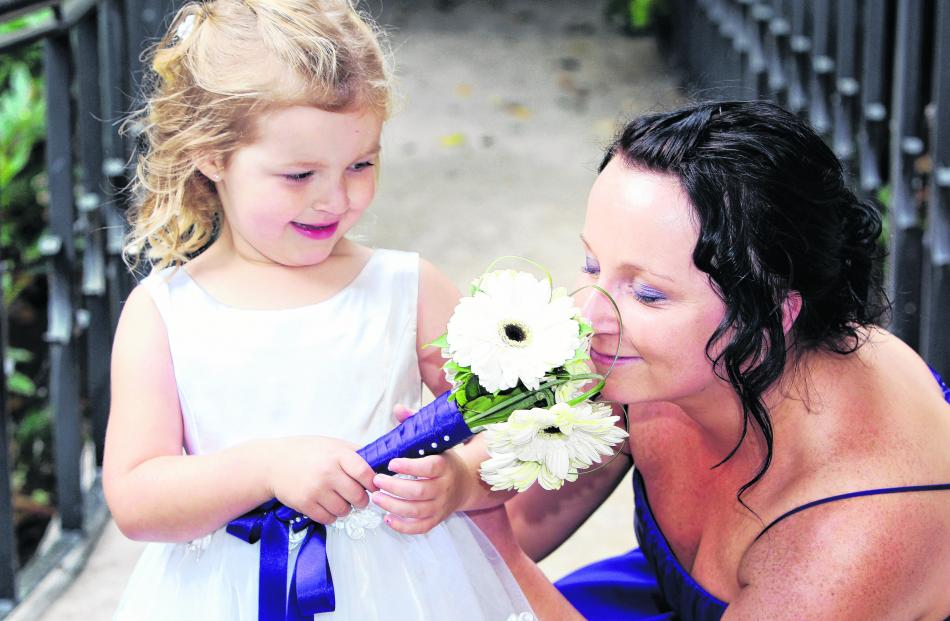 The flower girl and bridesmaid at the February wedding of Stephanie McLoed and Rick Dunphy at...