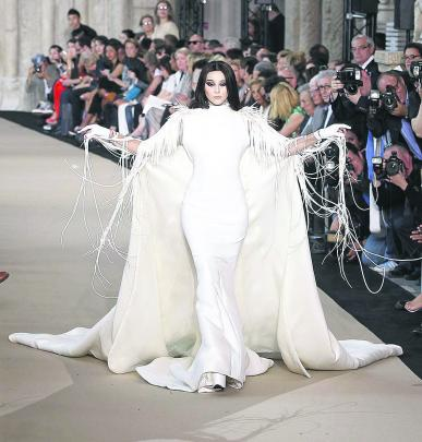 Actress Fan Bingbing presents a bridal creation French designer Stephane Rolland in his haute...