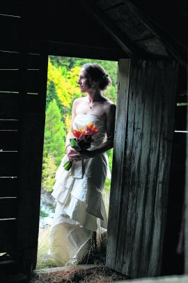 Robyn Crighton in Queenstown on her wedding day. SUE WILLIAMS PHOTOGRAPHY.