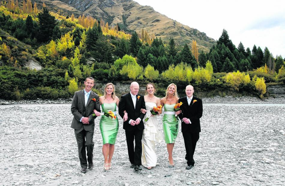 Barney Fraser and Robyn Crighton and their wedding party at the Shotover River, Queenstown. SUE...
