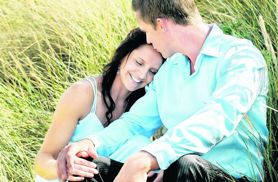 Josh Berga and Nicky Guild, whose wedding ceremony in February was held on Aramoana Beach,...