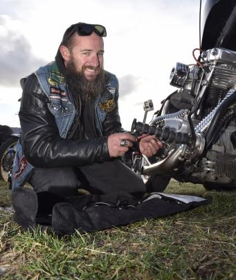 Carrying out a quick repair to the ignition system on his 1980 Harley-Davidson Shovelhead, is...