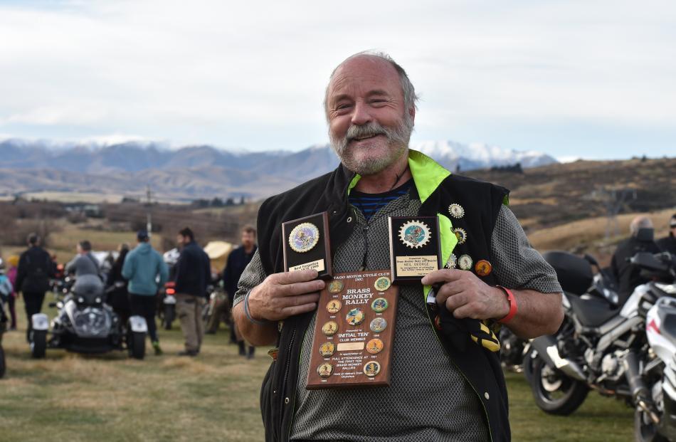 Neil George , of Dunedin, is proud to wear mementos from the 40 Brass Monkey Rallies he has...