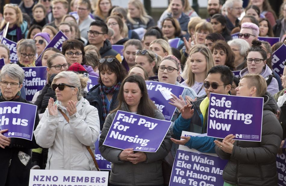 Striking nurses listen to speeches in The Octagon in Dunedin today. Photos: Gerard O'Brien