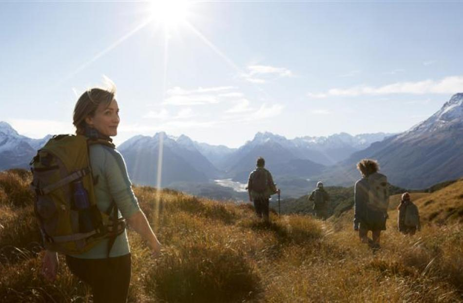 Trampers on Mt Alfred, Glenorchy, as seen in the new '100% Middle-earth, 100% Pure New Zealand'...