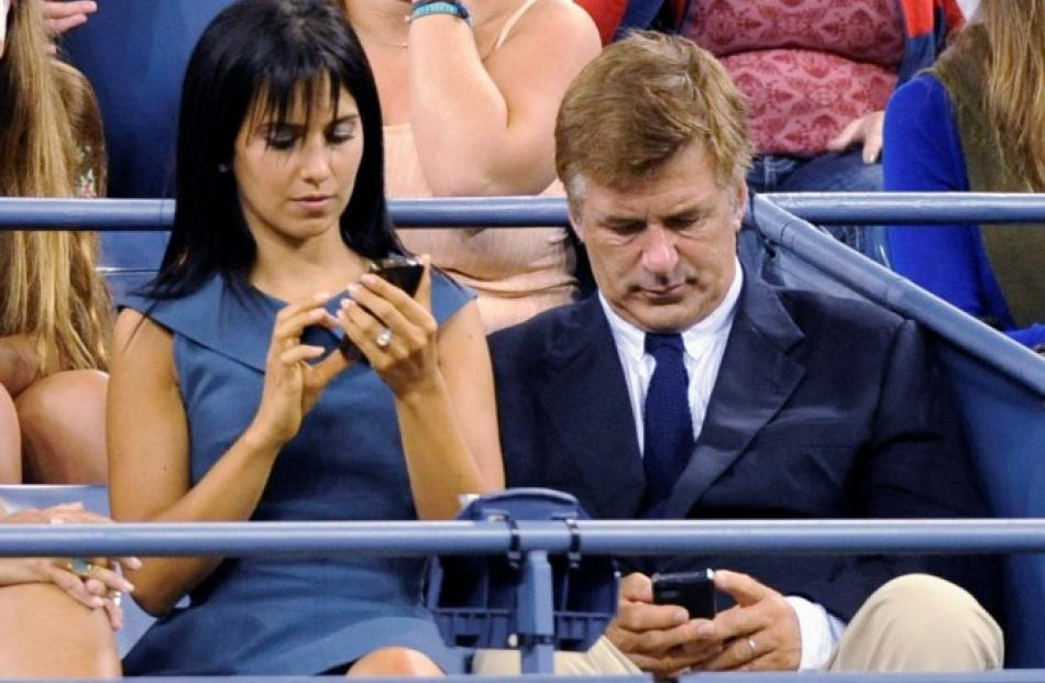 Actor Alex Baldwin (R) and wife Hilaria Thomas attend the opening night matches at the US Open...