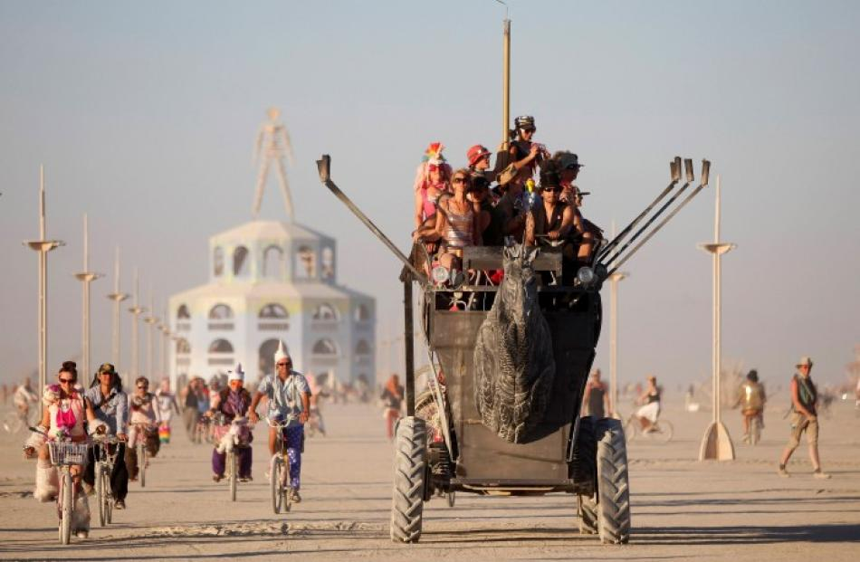 Participants ride an art car during the Burning Man 2012 'Fertility 2.0' arts and music festival...