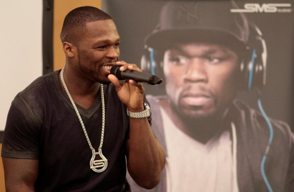 Rapper Curtis '50 Cent' Jackson addresses a news conference on his signature headphones by sms...