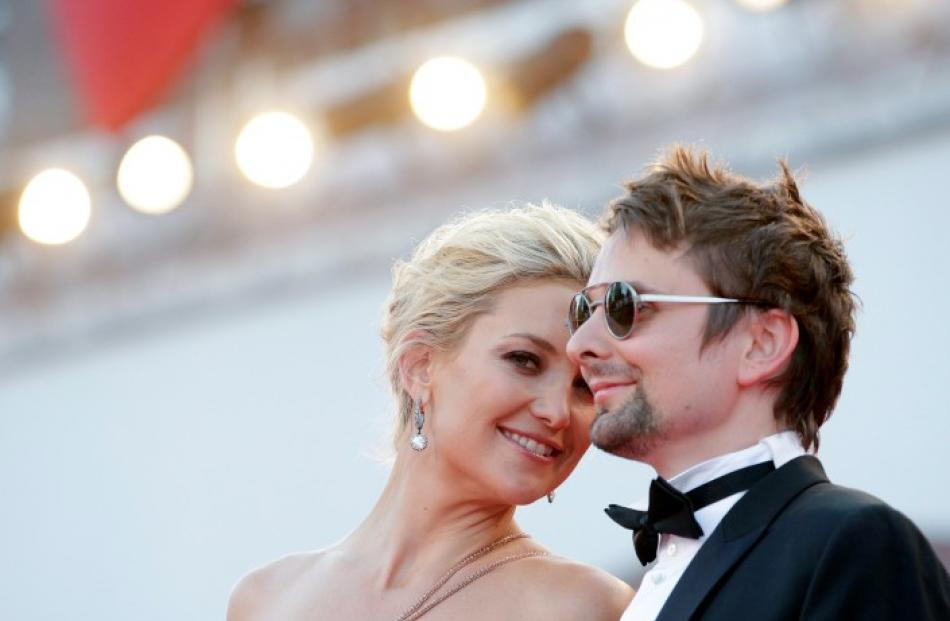 US actress Kate Hudson and British musician Matt Bellamy arrive for the red carpet for the movie ...