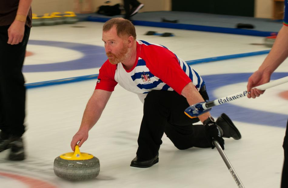 Former New Zealand Olympic curler Warren Dobson aims yesterday.