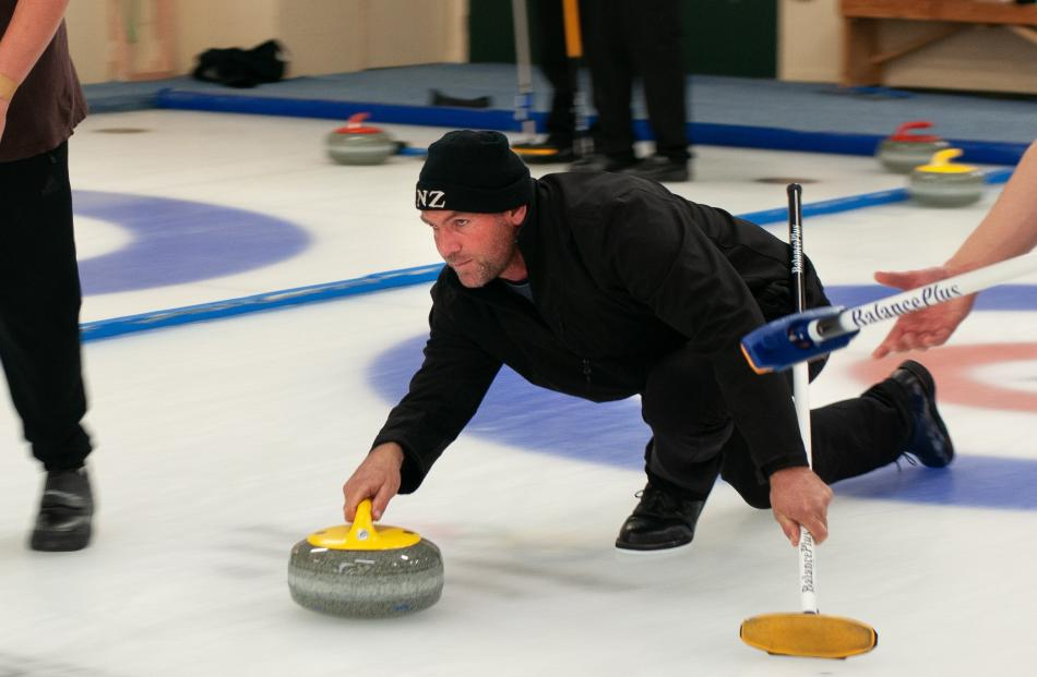 Former New Zealand Olympic curler Sean Becker shows his skill yesterday.