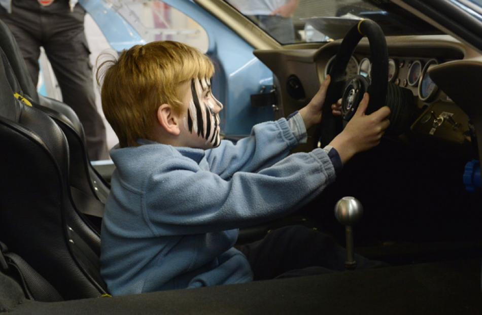 Brock Wilson (6) of Dunedin, sits in a Ford GT40.