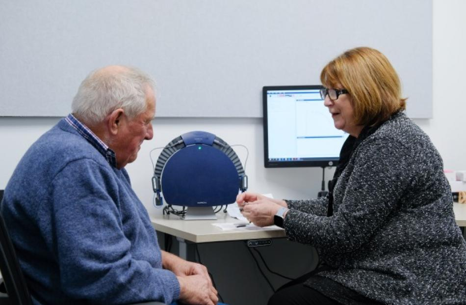 Senior Audiologist Anne McElwain of Audiology South with client Ron Robinson