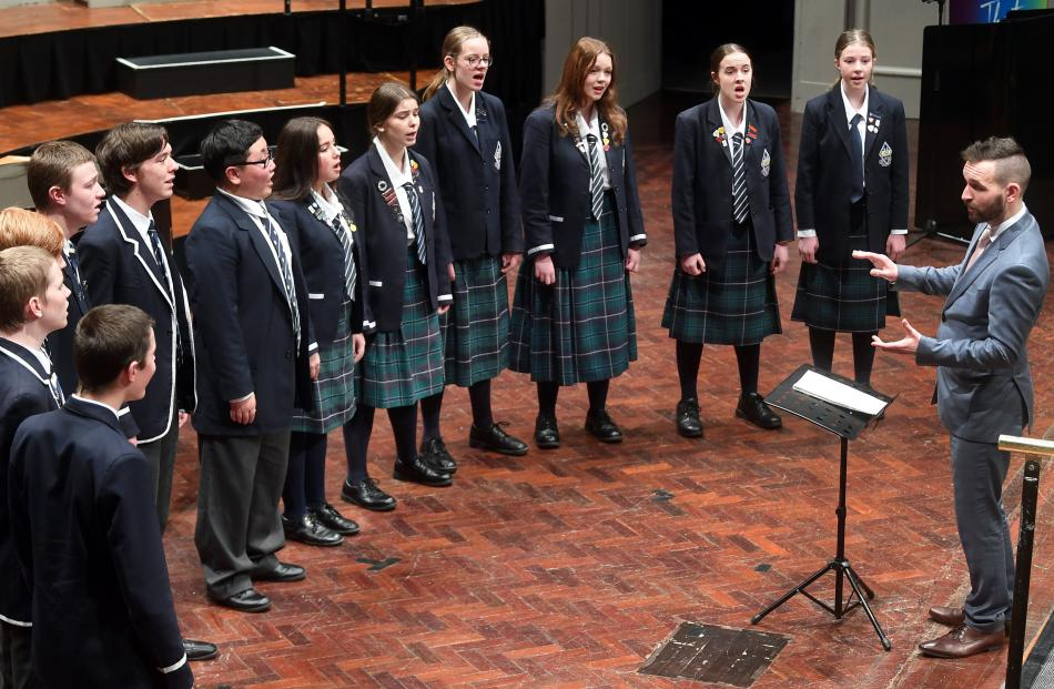 Otago Boys' and Otago Girls' High School band Fortress sing with music director Ben Madden.