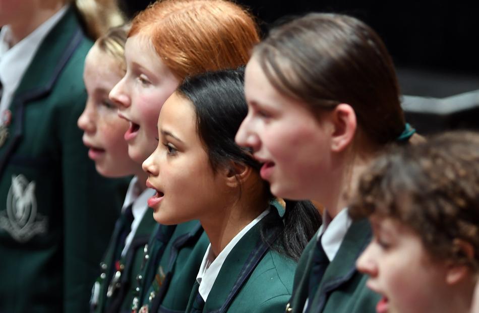 Columba College's Junior Madrigal Choir sings a tune.