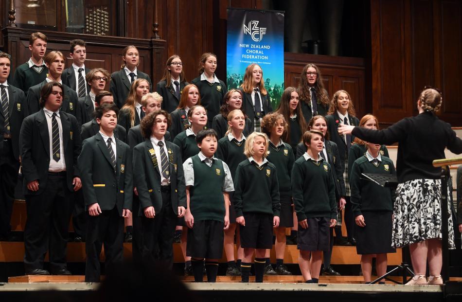Choir director Megan Kolppanen puts Bayfield High School's choir Dolce Concordance through its...