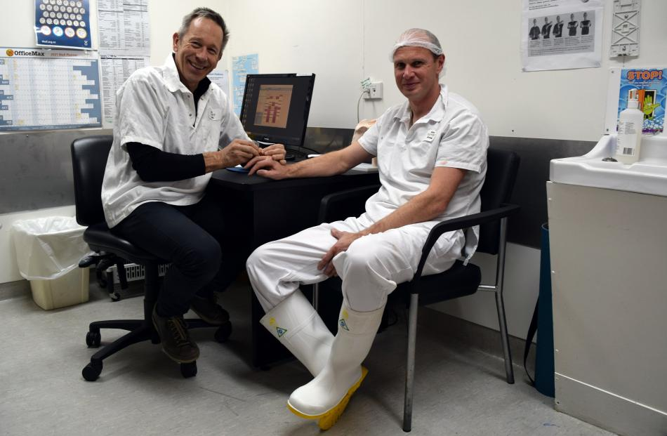 Oamaru Physiotherapy Clinic co-practice principal Mike Stewart (left) treats the injured finger...