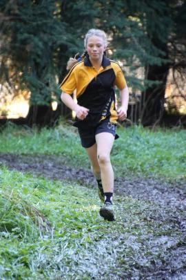 Takitimu Primary School pupil Ava Hindrup, who won the 12-year-old girls race, picks her way...